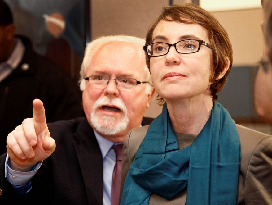 Ron Barber, seen here in January with then-Rep Gabrielle Giffords, Arizona Democrat, hopes to keep the seat that his former boss relinquished in the Democratic column in a special election on Tuesday. It is one of three House seats currently vacant. (Associated Press)