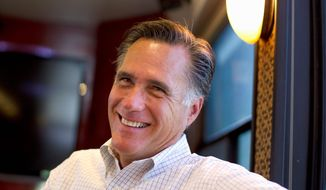 On the campaign trail, presumed Republican presidential nominee Mitt Romney tells voters to look at his record as governor in Massachusetts, where he balanced the budget every year. (Associated Press)