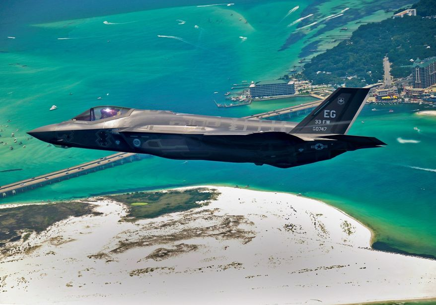 An F-35 Joint Strike Fighter soars over Destin, Fla., before landing at its new home at Eglin Air Force Base. Purchasing more of the fighters would be off the table in 2014 if automatic federal spending cuts go into effect. (Associated Press)