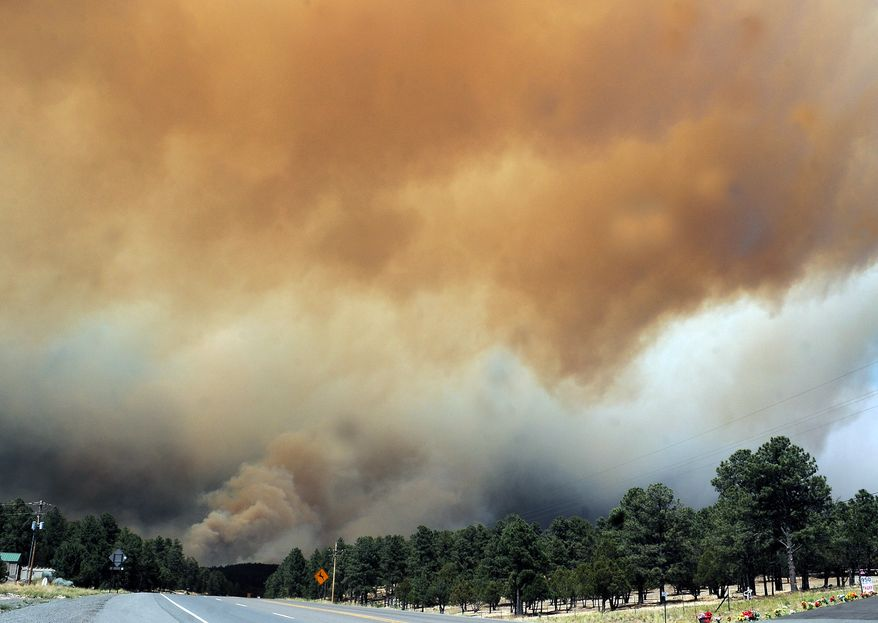 Smoke billows from the Little Bear fire in southeastern New Mexico, near Ruidoso, on Saturday, June 9, 2012. (AP Photo/Roswell Daily Record, Mark Wilson)