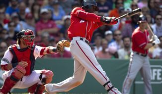 Washington Nationals' Roger Bernadina hits an RBI-double off a pitch from Boston Red Sox's Alfredo Aceves as Red Sox catcher Jarrod Saltalamacchia looks on in the ninth inning of a baseball game at Fenway Park in Boston, Sunday, June 10, 2012. The Nationals beat the Red Sox 4-3. (AP Photo/Steven Senne)