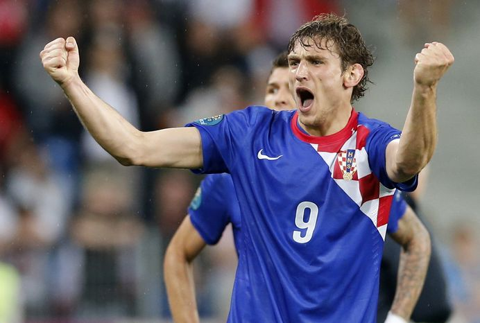 Croatia's Nikica Jelavic celebrates after scoring his side's second goal during the Euro 2012 soccer championship Group C match between Ireland and Croatia in Poznan, Poland, Sunday, June 10, 2012. (AP Photo/Antonio Calanni)