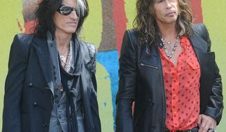 ** FILE ** Joe Perry (left) and Steven Tyler of Aerosmith in June 2012. (Associated Press)