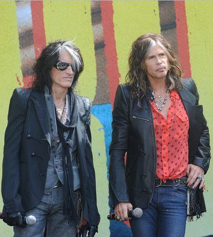 ** FILE ** Joe Perry (left) and Steven Tyler of Aerosmith in June 2012. (Associated Press)