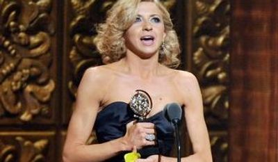 """Nina Arianda, 27, accepts the Tony for leading actress in a play for """"Venus in Fur"""" at Sunday's Tony Awards in New York. She is one of five first-time winners, all younger than 40, hailed as Broadway's next class. (Invision via Associated Press)"""