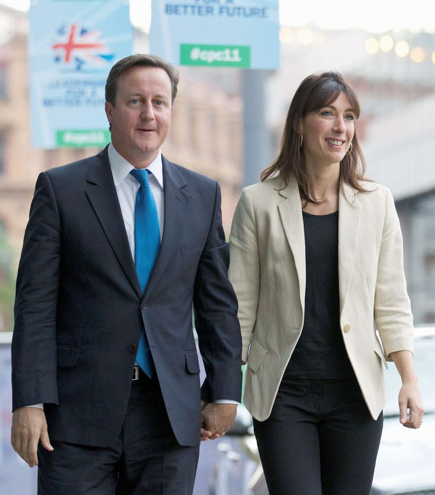 British Prime Minister David Cameron and his wife, Samantha, drove away from a pub in separate cars, each thinking their 8-year-old daughter Nancy was riding with the other. The girl had gone to the bathroom and was still in the pub. (Associated Press)