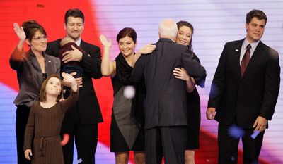 Republican presidential nominee John McCain hugs Bristol Palin as he celebrates with the Palin family - Sara with Piper, Todd with Trig and Willow - and Bristol's then-boyfriend, Levi Johnston, after his acceptance speech at the 2008 Republican National Convention. (Associated Press)