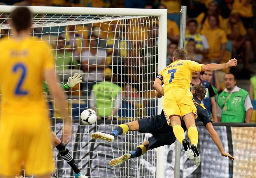 Team captain Andriy Shevchenko (7) heads in one of his two goals in Ukraine's 2-1 win over Sweden in a Euro 2012 Group D match in Kiev, Ukraine.