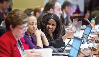 Attorneys for Delegate Tiffany T. Alston (center), Prince George's Democrat, say charges against her are politically motivated, because she has publicly clashed with Democratic leaders over such issues as congressional redistricting and same-sex marriage during her year and a half in office. (Andrew Harnik/The Washington Times)