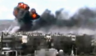 This video image taken from amateur video and broadcast by Bambuser/Homslive shows a series of devastating explosions rocking the central Syrian city of Homs on June 11, 2012. Live streaming video caught the devastation during one of the heaviest examples of violence since the uprisings began more than a year ago. (Associated Press/Bambuser/Homslive via AP video)
