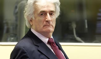**FILE** Former Bosnian Serb leader Radovan Karadzic enters the courtroom of the United Nation's Yugoslav war crimes tribunal in The Hague on Nov. 3, 2009. (Associated Press)