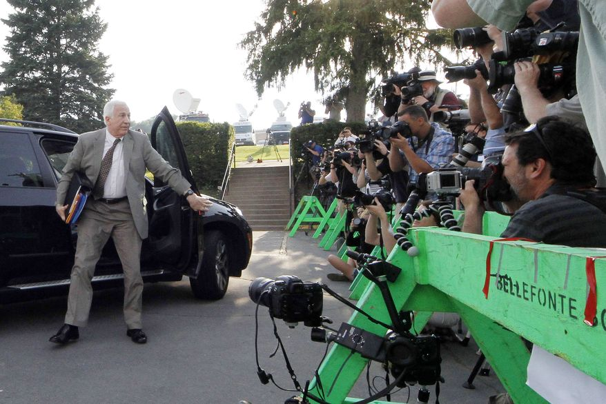Former Penn State University assistant football coach Jerry Sandusky (left) arrives June 11, 2012, at the Centre County Courthouse in Bellefonte, Pa., for opening statements in his trial on 52 counts of child sexual abuse involving 10 boys over a 15-year period. (Associated Press)