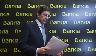 **FILE** Bankia president Jose Ignacio Goirigolzarri arrives May 26, 2012, for a press conference at the bank's headquarters in Madrid. (Associated Press)