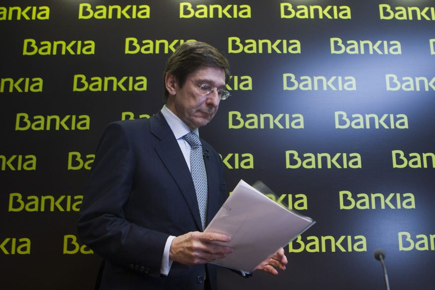 **FILE** Bankia president Jose Ignacio Goirigolzarri arrives May 26, 2012, for a press conference at the bank's headquarters in Madrid. (Associated Press)