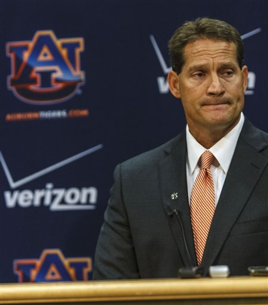 Auburn coach Gene Chizik talks about the shootings of college students including a couple of football players with the media on Tuesday, June 12, 2012, in Auburn, Ala. (AP Photo/Opelika-Auburn News, Vasha Hunt)