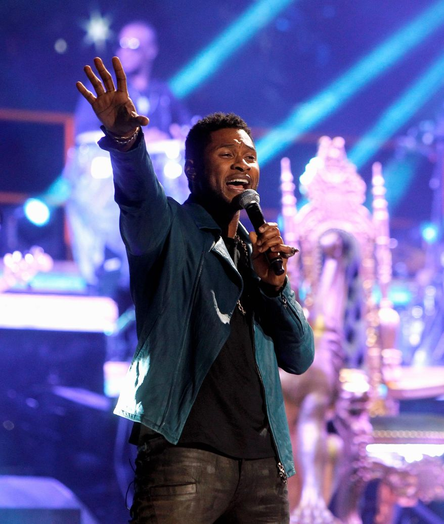 **FILE** Usher performs Feb. 24, 2012, during a guest appearance at a Romeo Santos concert at Madison Square Garden in New York. (Associated Press)