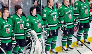 University of North Dakota hockey players wear Fighting Sioux jerseys on March 16, 2012. The jersey were later replaced during the WCHA Final Five Championships in St. Paul, Minn. (Associated Press) **FILE**