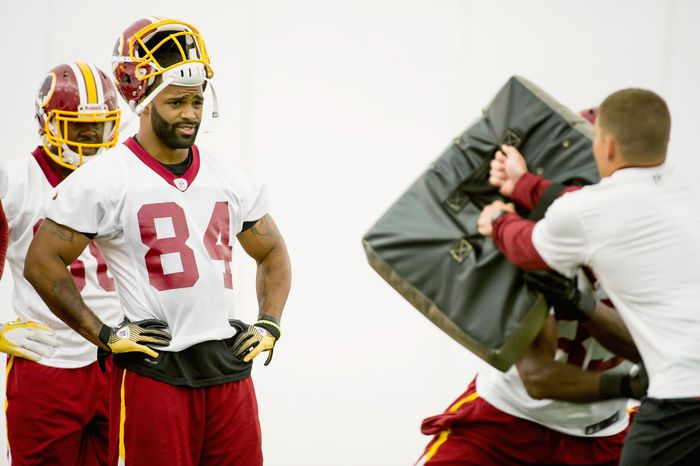 Redskins tight end Niles Paul stands in line to run a drill in the team's indoor training facility during minicamp at Redskins Park in Ashburn. Paul was switched from wide receiver to tight end in the offseason.  (Andrew Harnik/The Washington Times)
