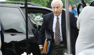 Jerry Sandusky arrives at the Centre County Courthouse in Bellefonte, Pa., for the second day of his sexual molestation trial Tuesday. The former Penn State assistant football coach listened to testimony from another coach, one of his accusers and a social worker. (Associated Press)