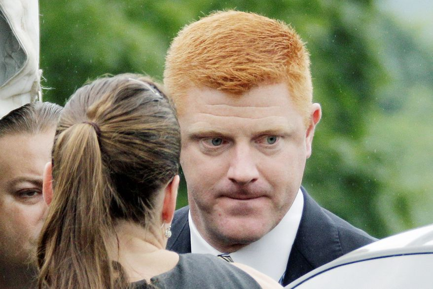 "Mike McQueary testified Tuesday that he heard ""skin-on-skin smacking sound"" when he saw Jerry Sandusky and a young boy in an on-campus shower in 2001. (Associated Press)"