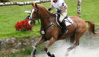 ** FILE ** Britain's Zara Phillips, a granddaughter of Queen Elizabeth II's, rides Toytown in the Cross Country Test competition at the World Equestrian Festival in Aachen, Germany, in July 2007. (AP Photo/Hermann J. Knippertz)