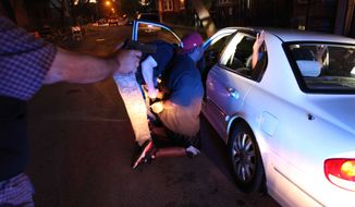 A high-speed pursuit of four suspected gang members on Chicago's West side ended with the Chicago Police gang unit questioning and arresting one of them on an outstanding warrant on June 9, 2012. (Associated Press)