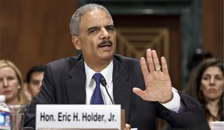 Attorney General Eric Holder testifies June 12, 2012, on Capitol Hill before a Senate Judiciary Committee hearing looking into national security leaks. (Associated Press)