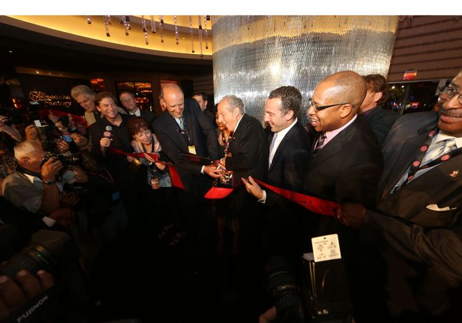 David Cordish (center), Chairmen of The Cordish Companies, and Anne Arundel County Executive John Leopold cut the traditional ceremonial ribbon to open the new $500 million Maryland Live! Casino at Arundel Mills, in Hanover, MD, on June 6, 2012. The new casino will feature 4,750 slot machines and electronic table games, making it the largest facility in Maryland and one of the largest casino properties in the gaming industry. (PRNewsFoto/Maryland Live! Casino)