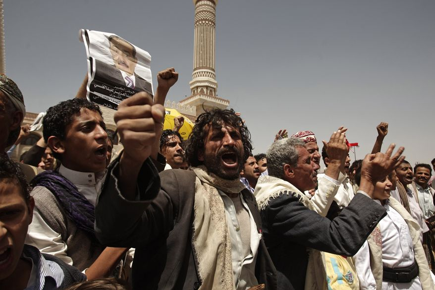 Supporters of former Yemeni President Ali Abdullah Saleh chant slogans outside the Saleh Mosque in Sanaa, Yemen, on Friday, May 25, 2012, during a rally to demand prosecution of those involved in an assassination attempt against Mr. Saleh. (AP Photo/Hani Mohammed)