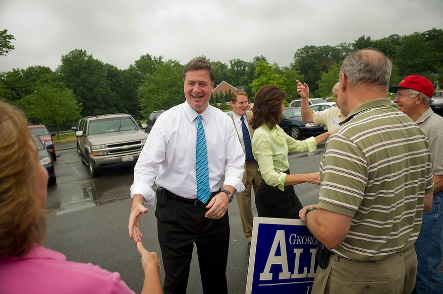 Former Virginia Governor and Republican U.S. Senate candidate George Allen and his wife Susan greet supporters as they arrive to cast their votes in the Republican Primary at Washington Mill Elementary School in Alexandria, Va., Tuesday, June 12, 2012. (Rod Lamkey Jr/The Washington Times)