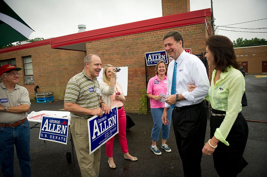 Former Virginia Governor and Republican U.S. Senate candidate George Allen and his wife Susan spend time talking with supporters after casting their votes in the Republican Primary at Washington Mill Elementary School in Alexandria, Va., Tuesday, June 12, 2012. (Rod Lamkey Jr/The Washington Times)