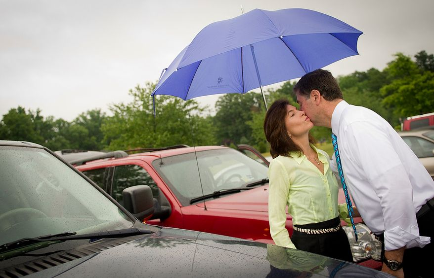 Former Virginia Governor and Republican U.S. Senate candidate George Allen kisses his wife Susan as they make their exits after casting their votes in the Republican Primary at Washington Mill Elementary School in Alexandria, Va., Tuesday, June 12, 2012. (Rod Lamkey Jr/The Washington Times)