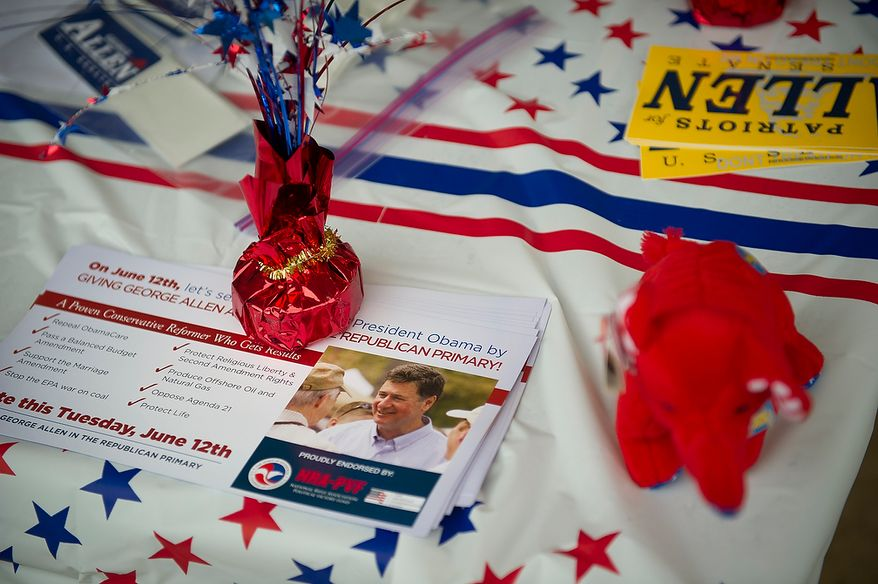 A table has offerings of campaign material for Former Virginia Governor and Republican U.S. Senate candidate George Allen at the Orange Hunt Elementary School precinct in Springfield, Va., Tuesday, June 12, 2012. (Rod Lamkey Jr/The Washington Times)