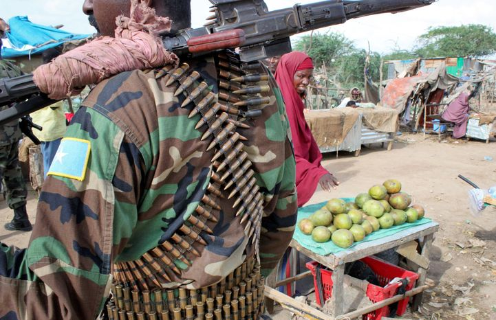 A Somali soldier stands guard at a market in Afgoye, a town west of the Mogadishu where Ugandan and Burundian wrested control from al-Shabab troops in late May. The Islamist rebels had used the area to control traffic in and out of the capital and extort money from anyone who wanted to enter or leave.
