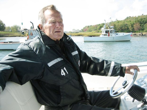 """Former President George H.W. Bush takes the wheel of his boat in Kennebunkport, Maine, during the filming of the documentary """"41,"""" which premieres Thursday on HBO. (HBO via Associated Press)"""