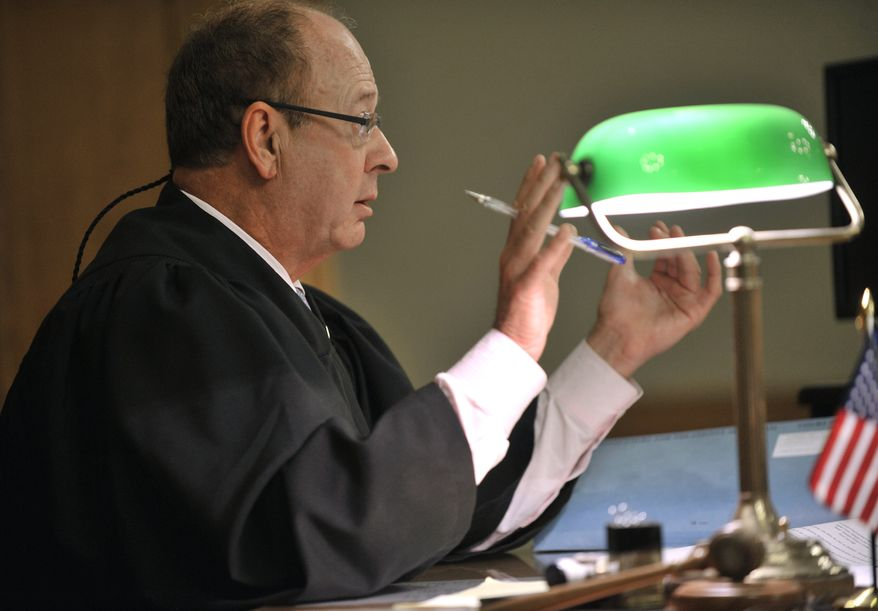 Judge William Collette listens to arguments on Wednesday, June 13, 2012, at the Ingham County Courthouse in Mason, Mich., before throwing out a suit by Detroit's corporate counsel after a lawyer for Mayor Dave Bing intervened and said the city's top attorney had no authority to challenge the city's financial agreement with the state. (AP Photo/Detroit News, Dale G. Young)