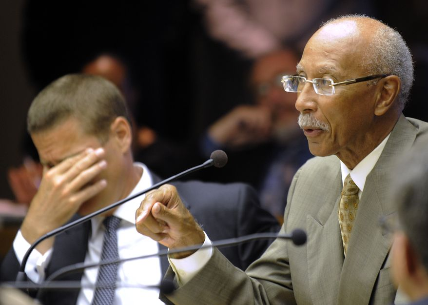 **FILE** Detroit Mayor Dave Bing (right) speaks before the Detroit City Council on Monday, June 11, 2012, as Chris Brown, the city's chief operating officer, listens at left. (AP Photo/The Detroit News, David Coates)