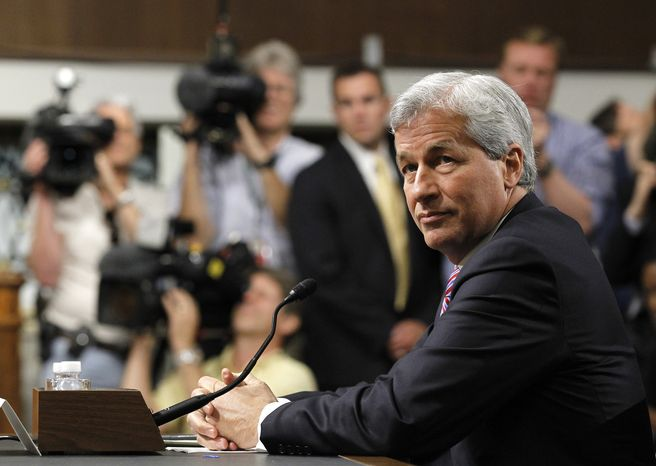JPMorgan Chase CEO Jamie Dimon, head of the largest bank in the United States, prepares to testify June 13, 2012, on Capitol Hill before the Senate Banking Committee about how his company recently lost more than $2 billion on risky trades and whether its executives failed to properly manage those risks. (Associated Press)