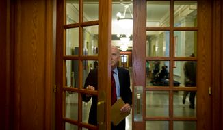 Interim D.C. Council Chairman Phil Mendelson makes his way to his new office in the John A. Wilson Building in Washington after being elected on Wednesday, June 13, 2012, to temporarily fill the seat vacated by former council Chairman Kwame R. Brown. (Rod Lamkey Jr./The Washington Times)