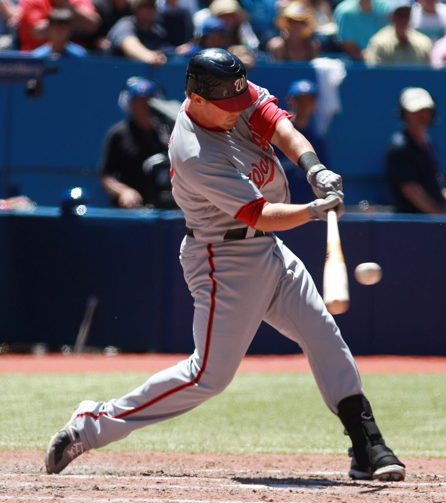 Washington Nationals' Tyler Moore hit two home runs in the team's 6-2 win over the Toronto Blue Jays on Wednesday to complete their second straight sweep. (AP Photo/Toronto Star, Rene Johnston via The Canadian Press)