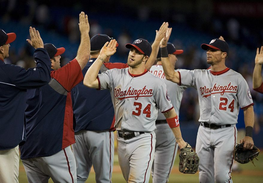 Washington Nationals' Bryce Harper went 3-for-4 with a home run in his team's 4-2 win over the Toronto Blue Jays on Tuesday night. (AP Photo/The Canadian Press, Aaron Vincent Elkaim)
