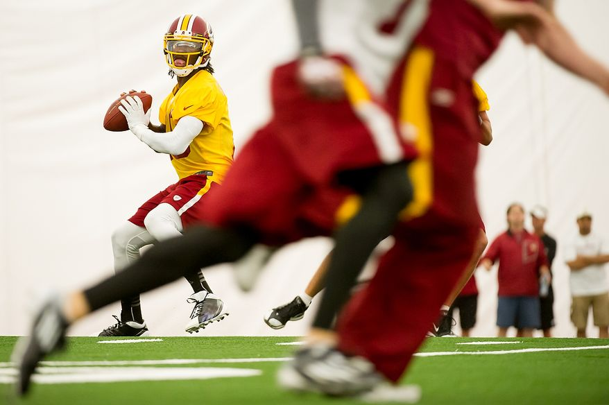 Redskins rookie quarterback Robert Griffin III is aware of the dangers of running the football since he tore the ACL in his right knee in 2009 on one of his 528 carries while at Baylor. While Shanahan wants to take advantage of Griffin's speed, he also knows the Heisman Trophy winner is capable of beating teams with his arm. (Andrew Harnik/The Washington Times)