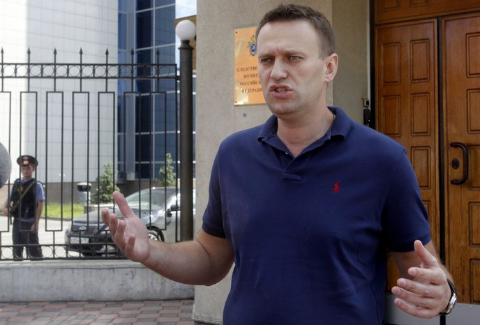 ** FILE ** Anti-corruption blogger Alexei Navalny speaks to the media as he arrives for questioning at the headquarters of Russia's Investigation Committee in Moscow on Wednesday, June 13, 2012. (AP Photo/Misha Japaridze)