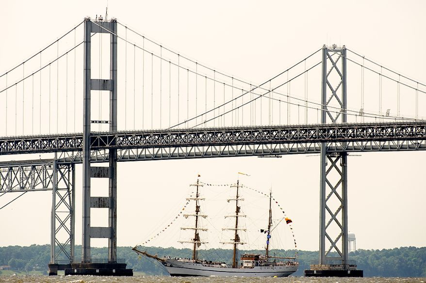 """A tall ship passes under the Chesapeake Bay Bridge at Sandy Point State Park in Annapolis, Md., en route to the Inner Harbor in Baltimore for a bicentennial commemoration of the War of 1812. The week-long """"Star-Spangled Sailabration"""" includes free tours of the ships, waterside festivities, an air show featuring the Blue Angels and the world premiere of """"Overture for 2012,"""" composed by Philip Glass. (Andrew Harnik/The Washington Times)"""