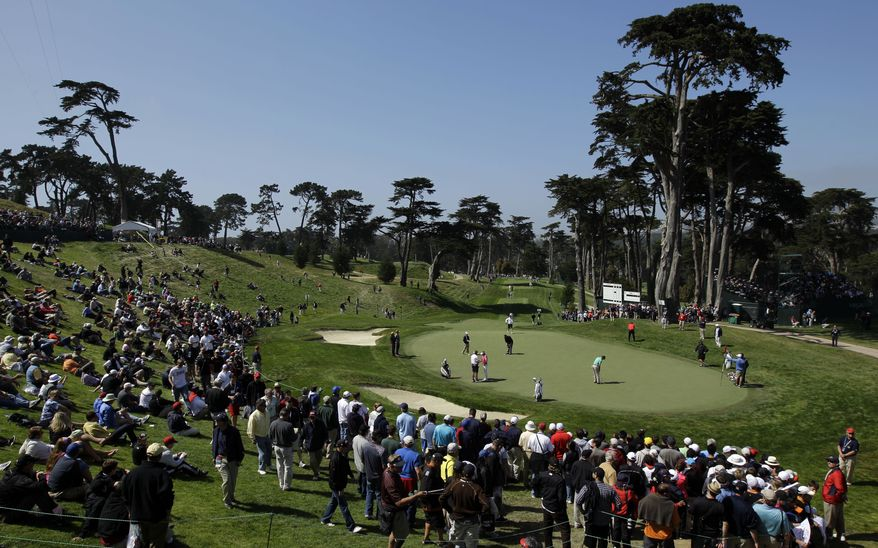 Players putt on the eighth green during a practice round for the U.S. Open Championship on Wednesday, June 13, 2012, at The Olympic Club in San Francisco. (AP Photo/Ben Margot)