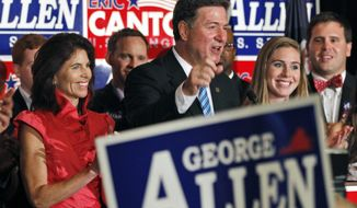 ** FILE ** Former Sen. George Allen celebrates with his wife, Susan (left), and daughter Tyler in Richmond on Tuesday, June 12, 2012, after securing a win in Virginia's Republican primary in his effort to reclaim his old Senate seat. (AP Photo/Steve Helber)