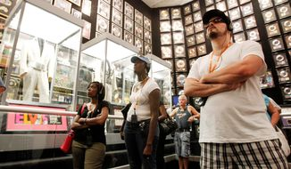 Tourists view the trophy room at Graceland, Elvis Presley's home in Memphis, Tenn. Graceland opened for tours on June 7, 1982. (Associated Press)