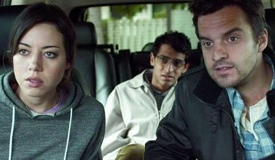 "Aubrey Plaza (left) and Karan Soni (backseat) play interns accompanying Jake M. Johnson on a story assignment about time travel in ""Safety Not Guaranteed."" (FilmDistrict via Associated Press)"