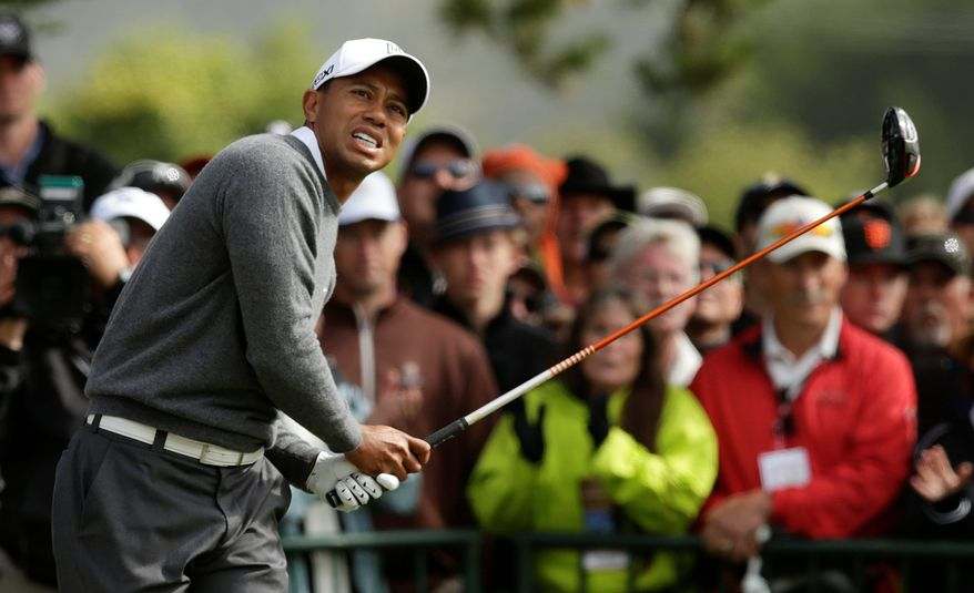 Tiger Woods carded a 69 for a seven-stroke lead over Phil Mickelson and a nine-shot advantage over Masters champion Bubba Watson in the U.S. Open. Woods is looking to rebound from a poor showing at the Masters. (Associated Press)