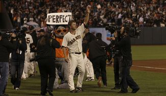 San Francisco Giants pitcher Matt Cain celebrates after his perfect game against the Houston Astros on Wednesday night. (AP Photo/Jeff Chiu)